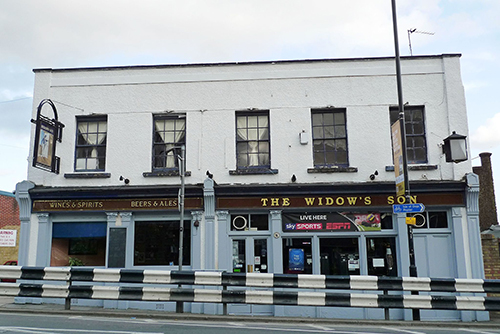 The Widow's Son pub in Bromley-by-Bow is famous for its collection of hot cross buns above the bar. But why are they hanging there? Click to find out.